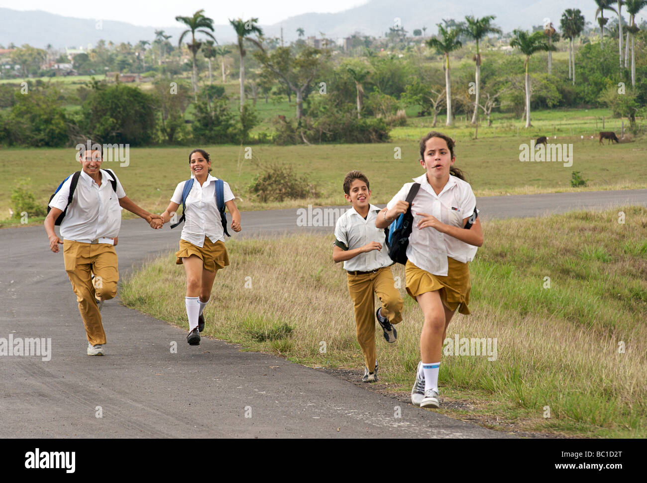 Schoolchildren running along the road, Pinar del Rio, Cuba Stock Photo