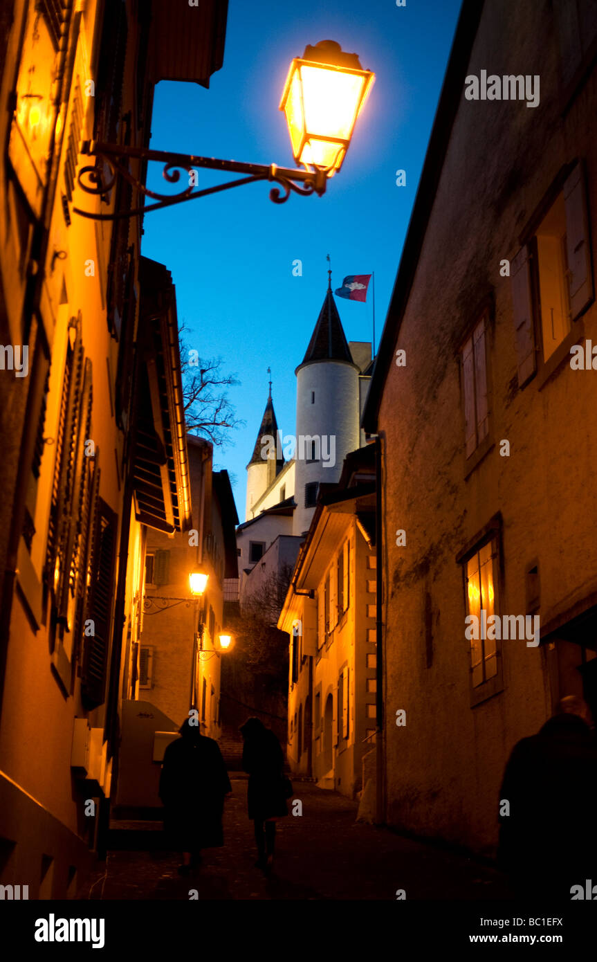 Old alley in Nyon at night, with the town's castle in the back, lake geneva region, Switzerland. - Stock Image
