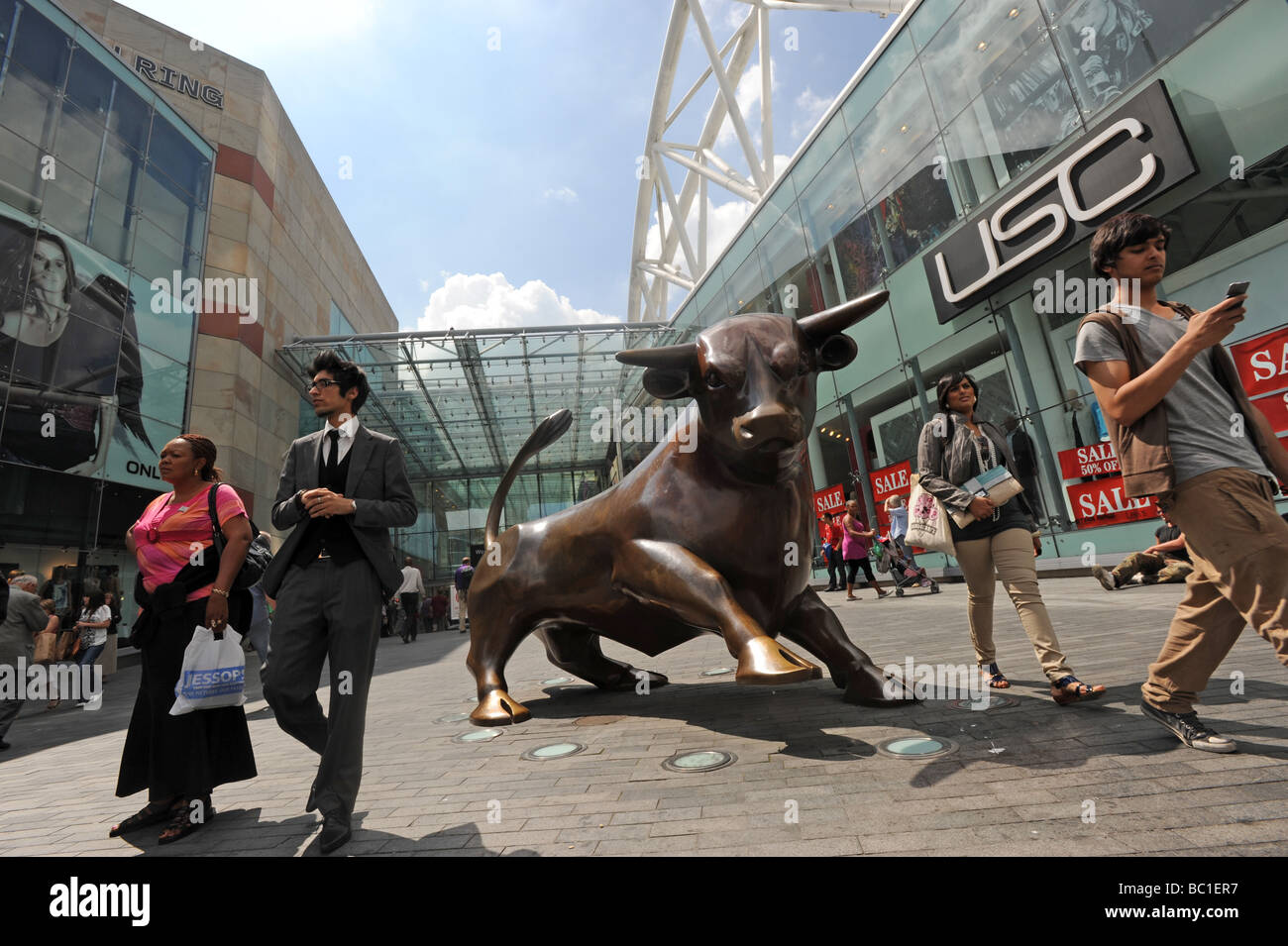 Shoppers at the entrance to the Bullring Shopping Centre in Birmingham England Uk - Stock Image
