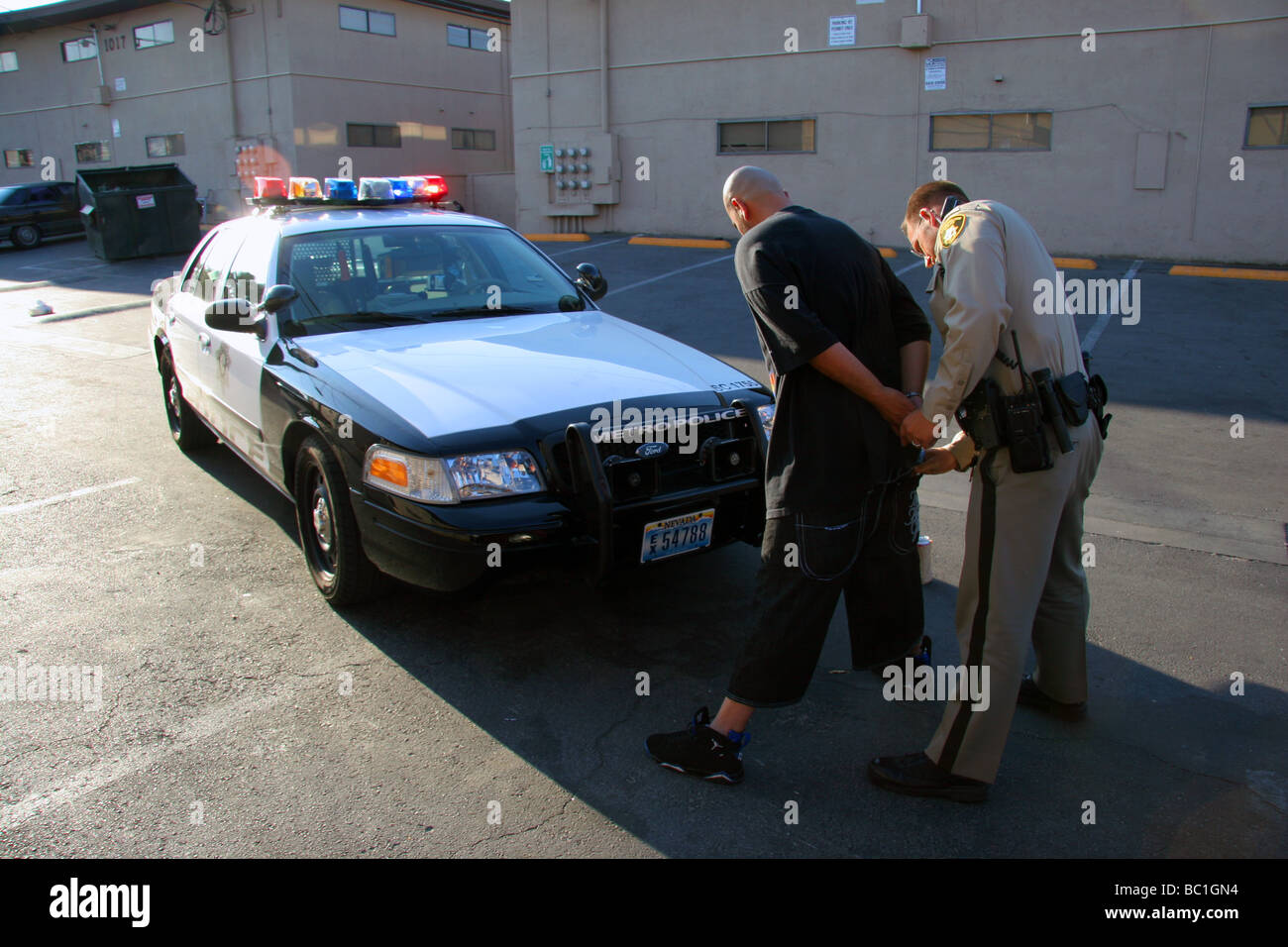 Man being searched by a Las Vegas police officer - Stock Image