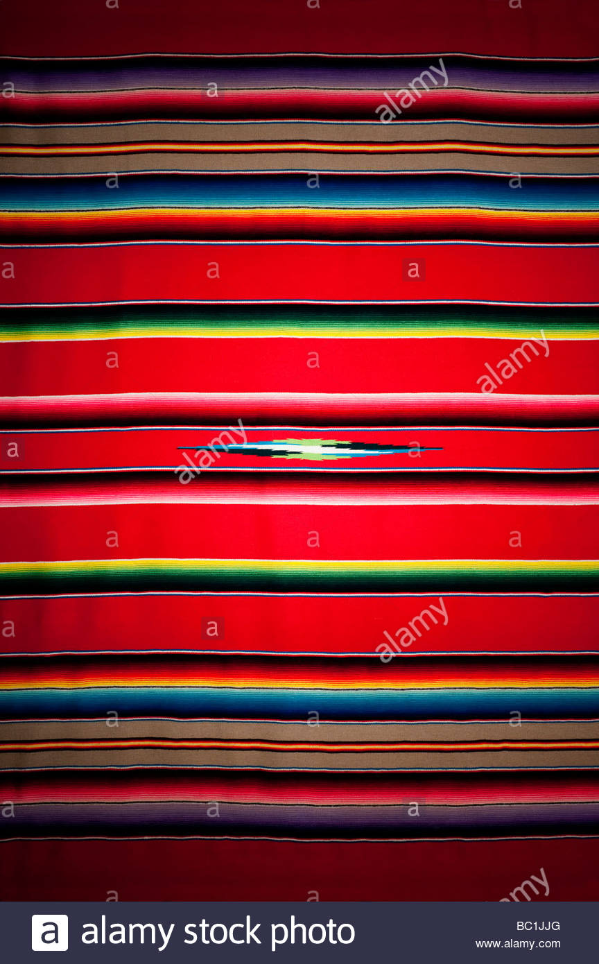 A traditional brightly colored Mexican Blanket this is an older version with higher quality weaving and brighter - Stock Image