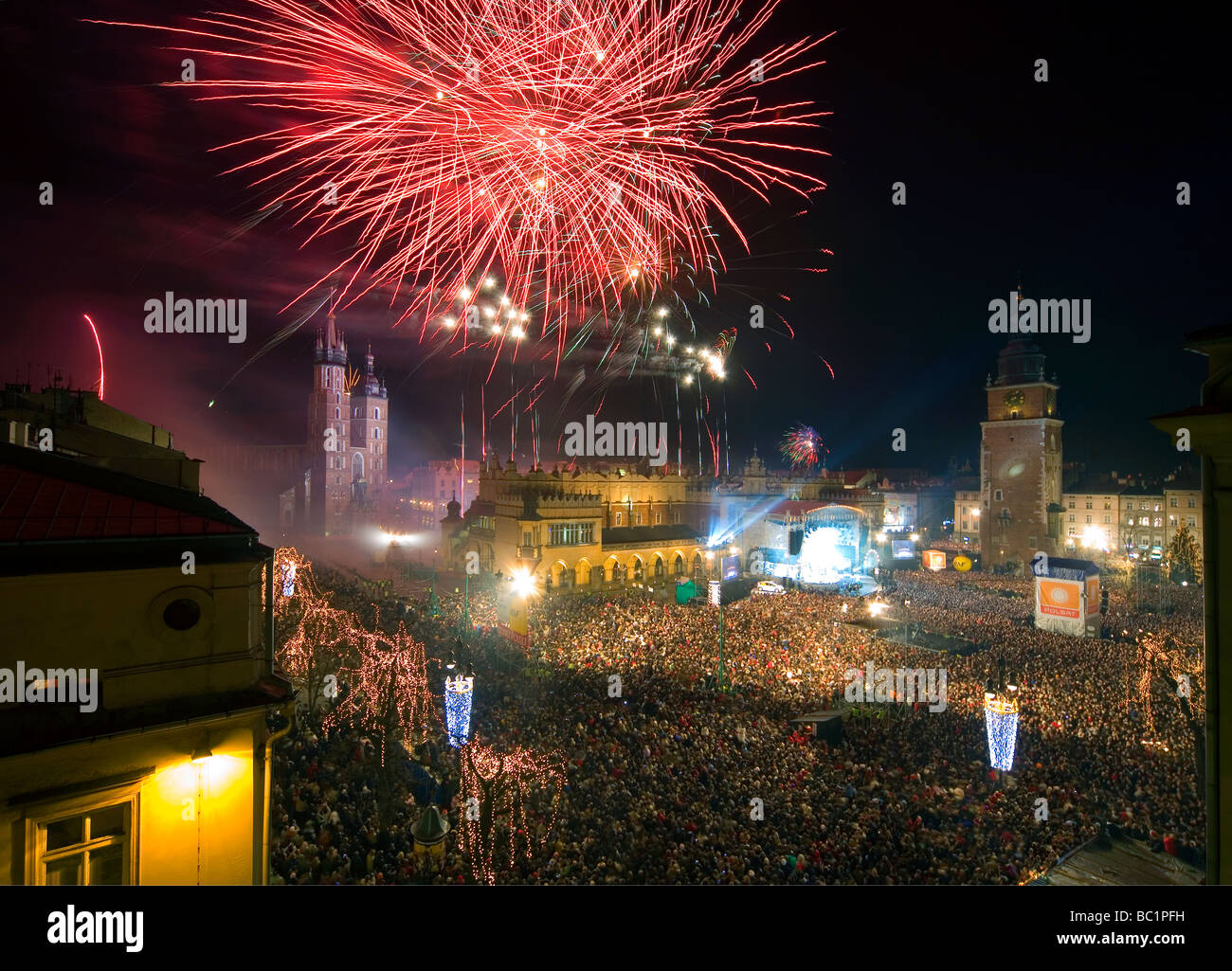 Poland Krakow New Year Eve celebration at biggest in Europe Square - Stock Image