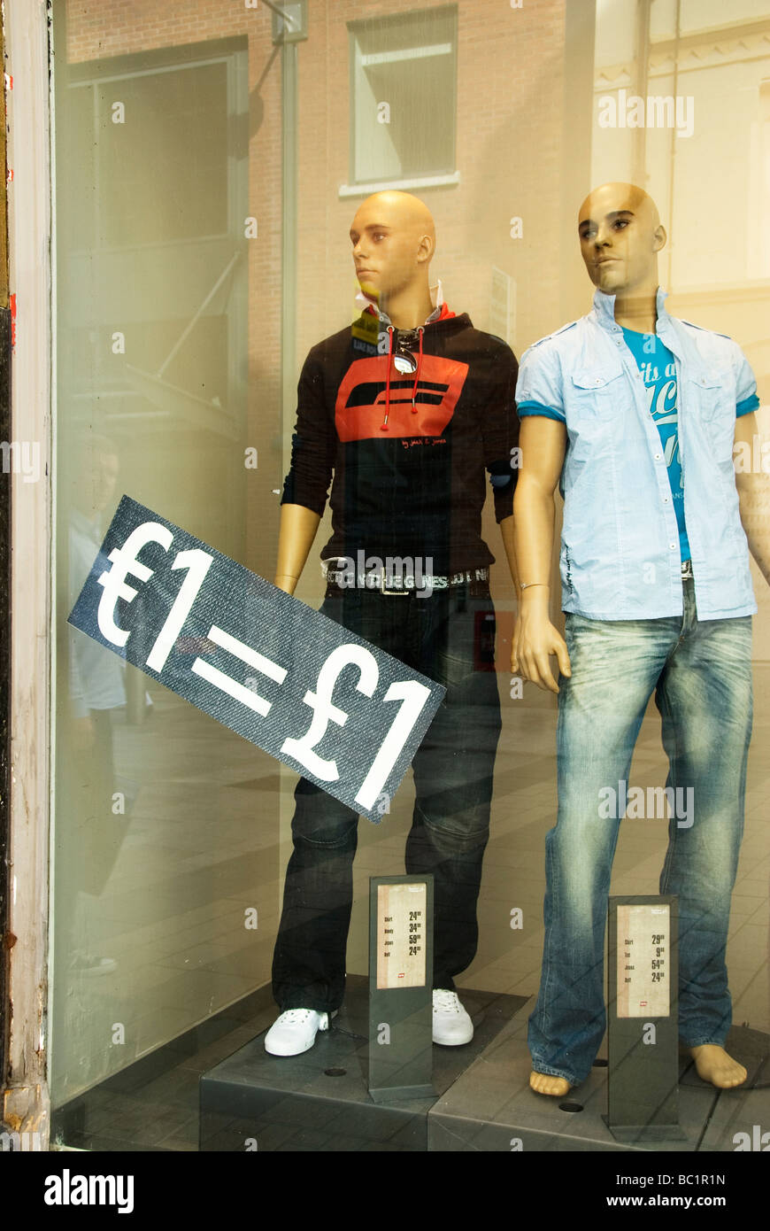 Belfast clothes shop One euro equals one pound Stock Photo