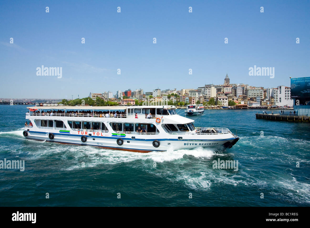 Ferry Boat on the Bosphorus , Galata Tower city Istanbul - Stock Image