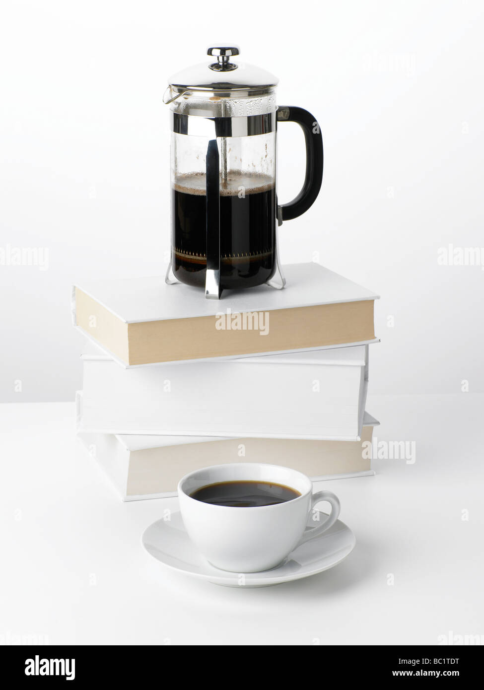 coffee cafetiere on books - Stock Image