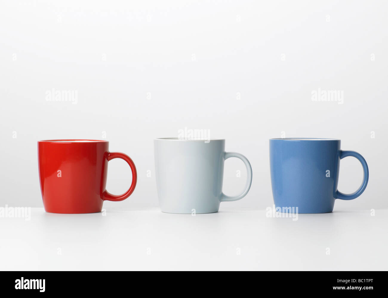 colored mugs red white and blue - Stock Image