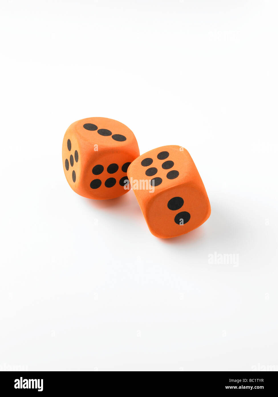 orange dice on white - Stock Image