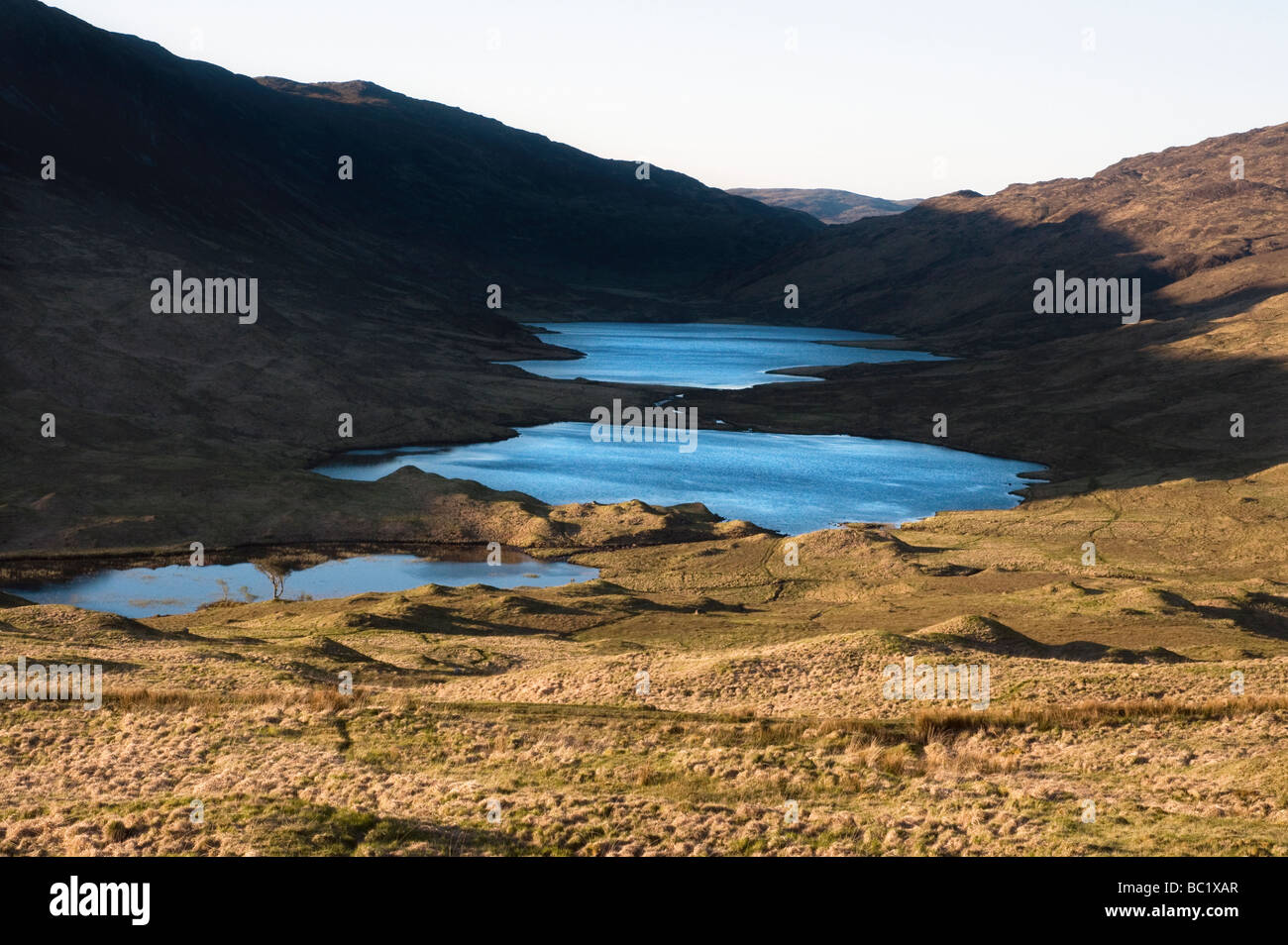 a study of contrasting light and shade using the spectacle lochs isle of mull scotland - Stock Image