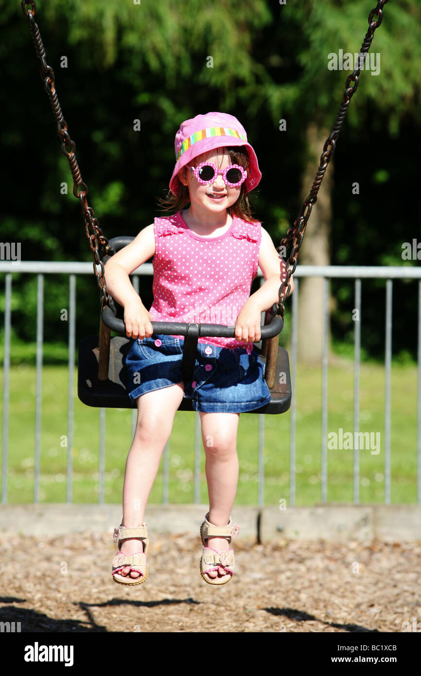 Two 2 Year Old Girl Pre School Toddler Young Child Swinging In Stock