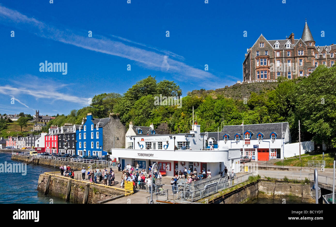 Harbour view of Tobermory on Mull in Scotland with colourful houses and pier - Stock Image