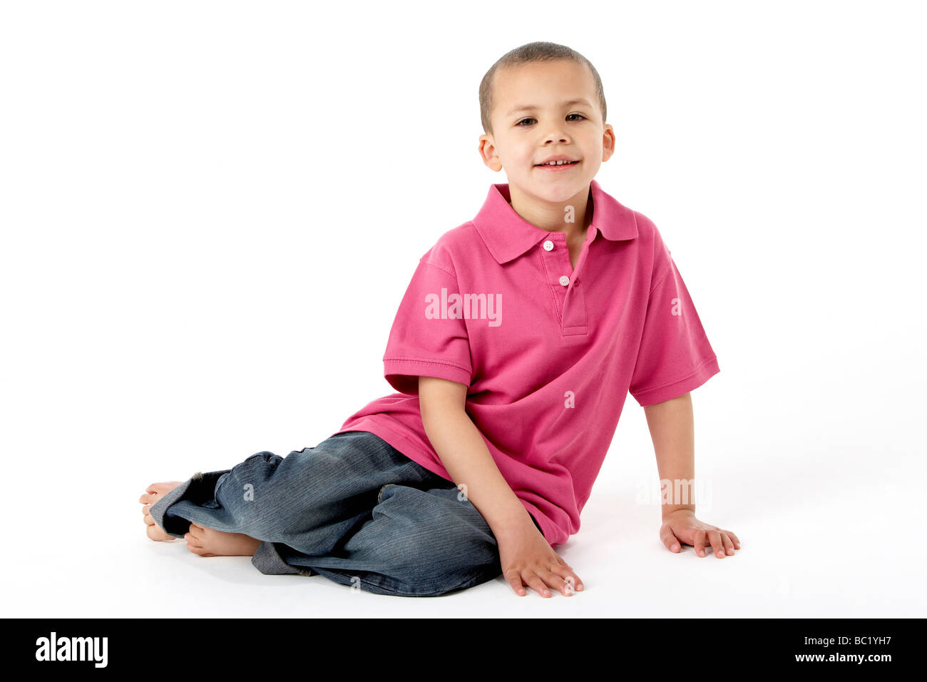 Young Boy Sitting In Studio - Stock Image