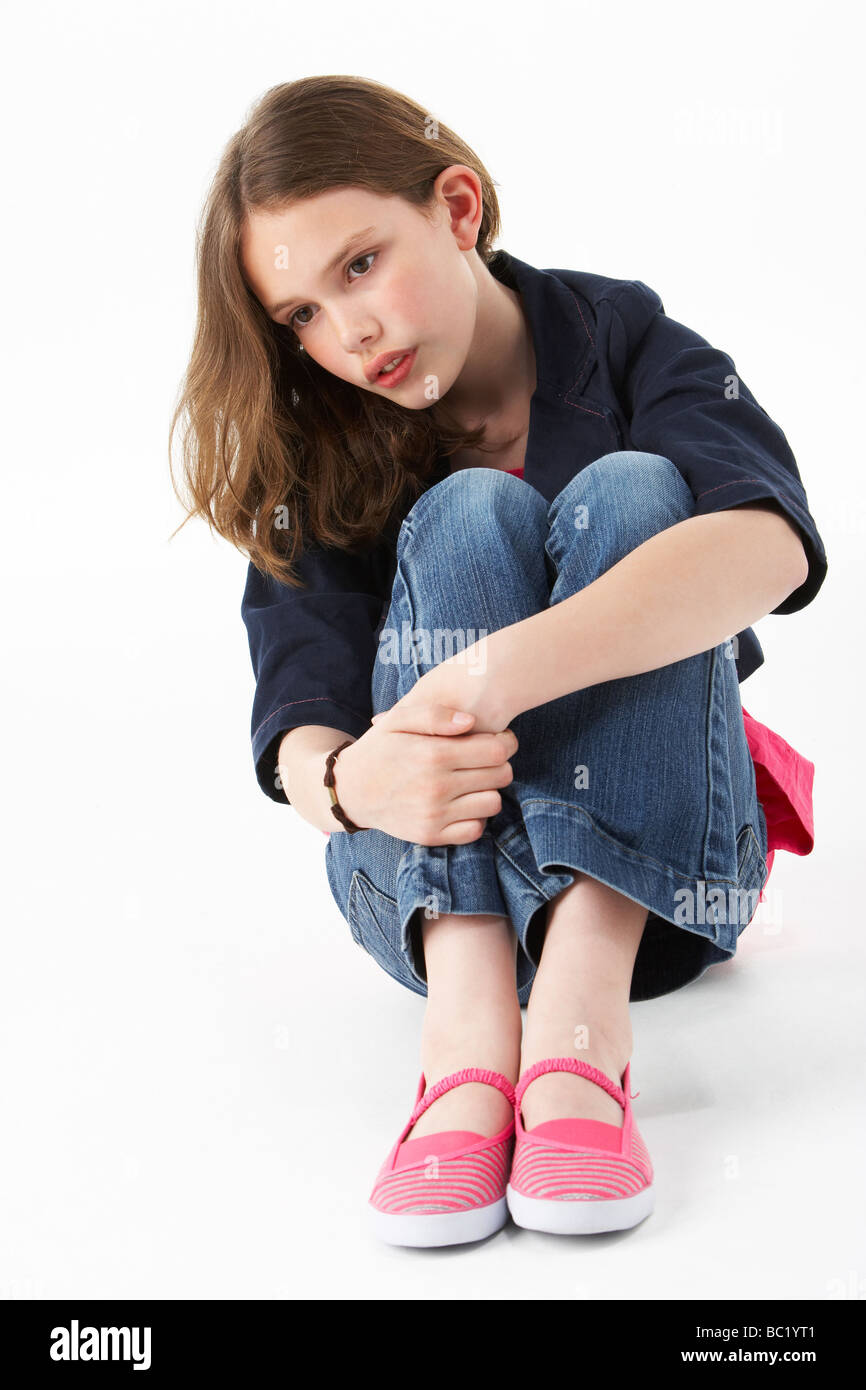 Young Girl Sitting In Studio - Stock Image