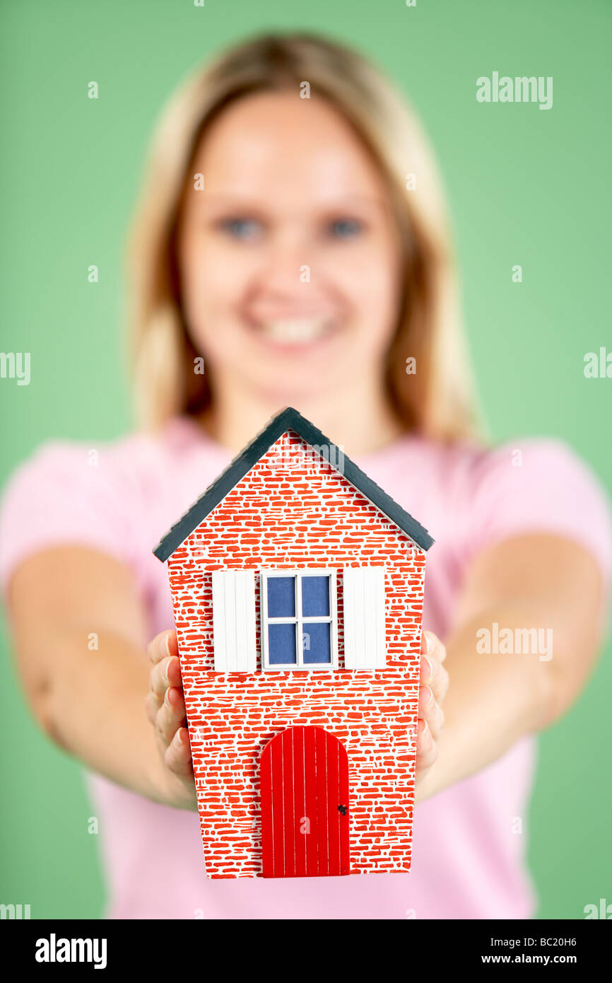 Woman Holding Model House - Stock Image