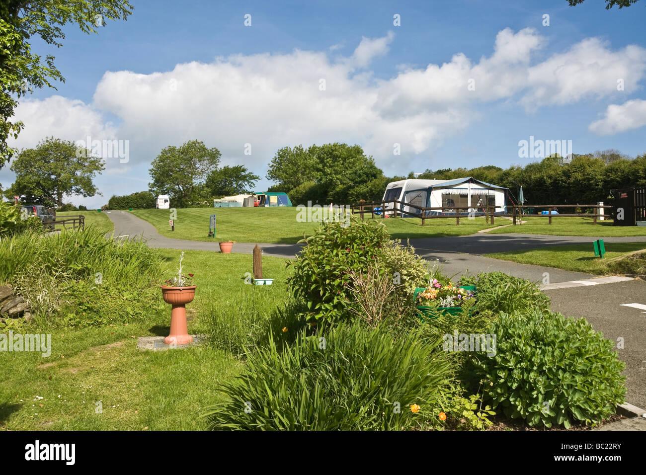 Caravan site at Cardigan Bay, Wales. Camping and Caravanning Club Site. - Stock Image
