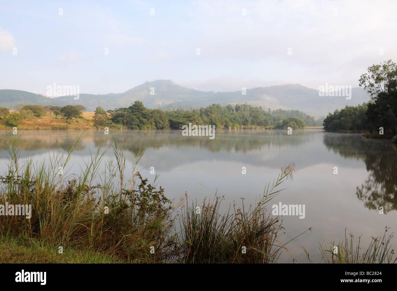 Early morning mist over Mhlambanyatsi river Mlilwane Wildlife Sanctuary Swaziland South Africa - Stock Image