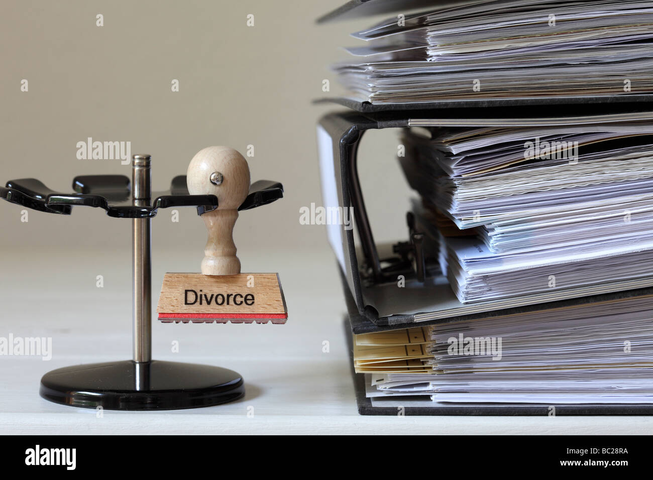 Stamp with inscription Divorce next to a pile of files - Stock Image