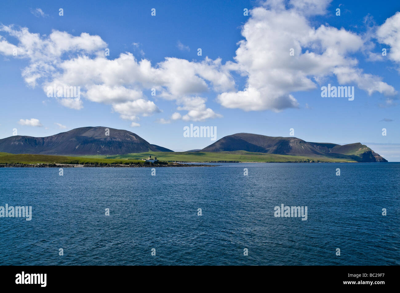 dh Graemsay HOY SOUND ORKNEY Oxan Point Low lighthouse Ward Hill Cuilags and Kame of Hoy scapa flow Stock Photo