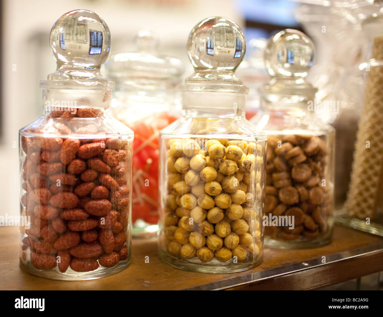 Glas filled with candy - Stock Image