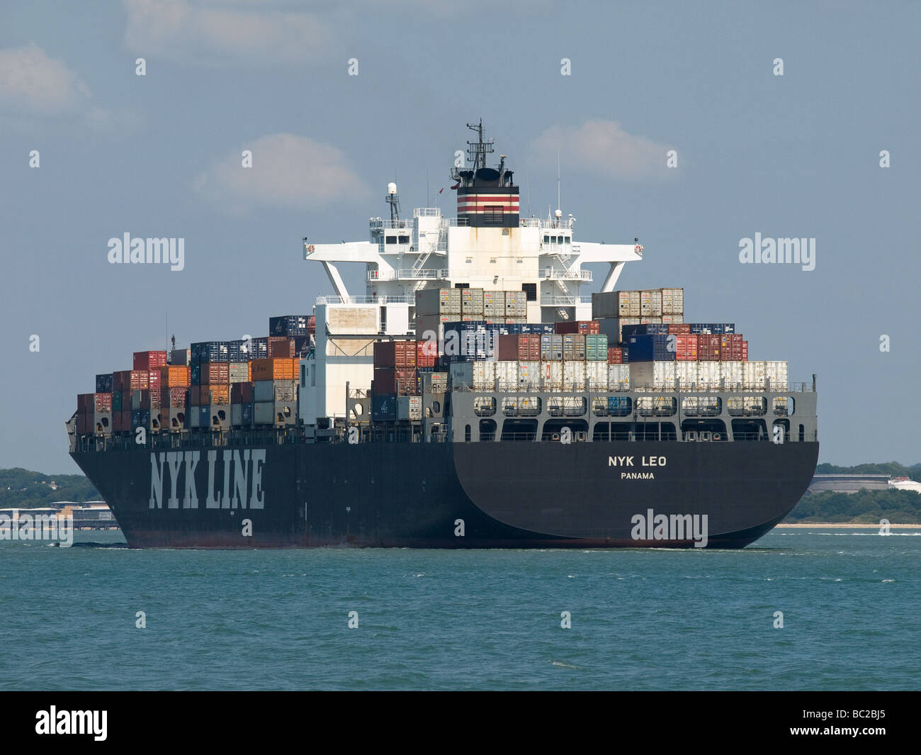 Container ship NYK Leo arriving at Southampton UK - Stock Image