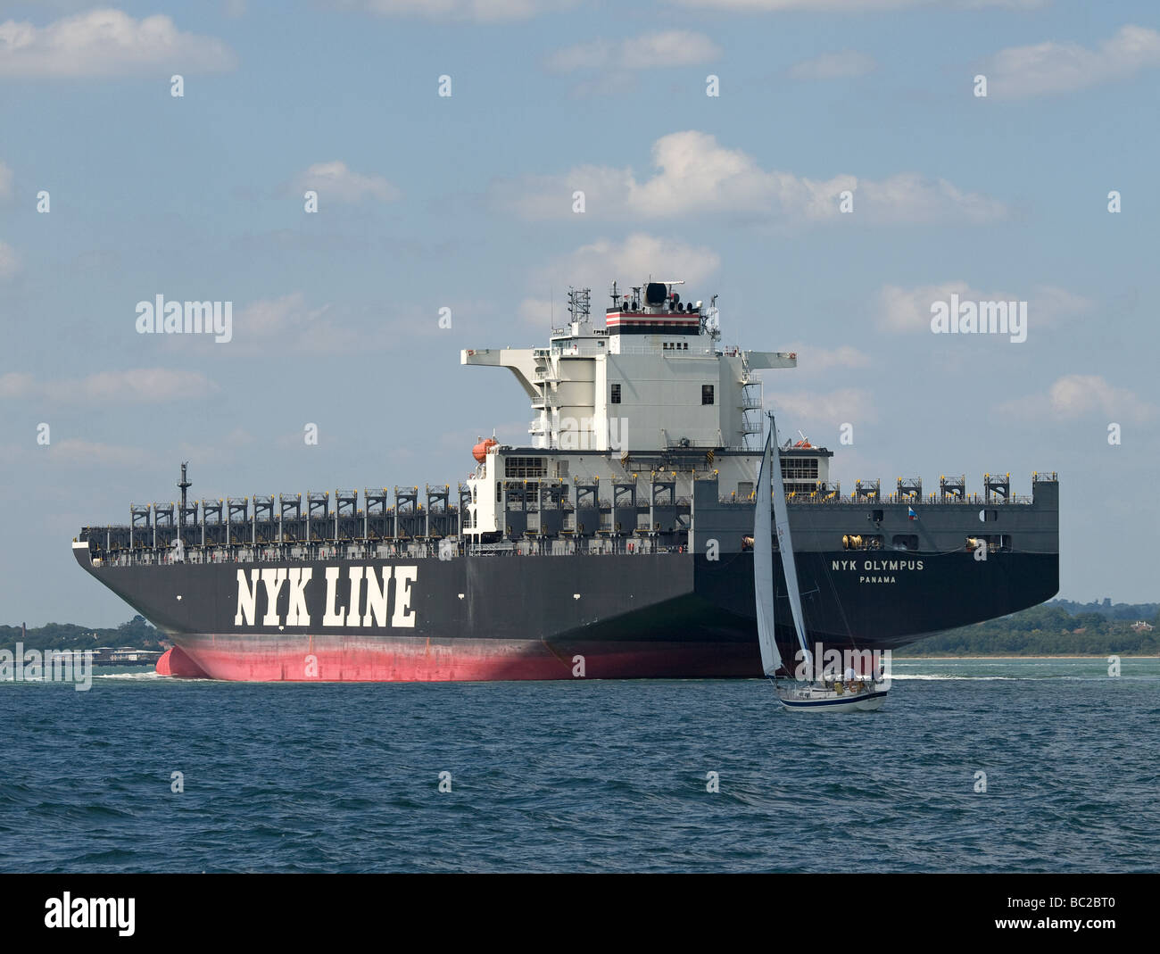 Empty container ship NYK Olympus arriving at Southampton UK Stock