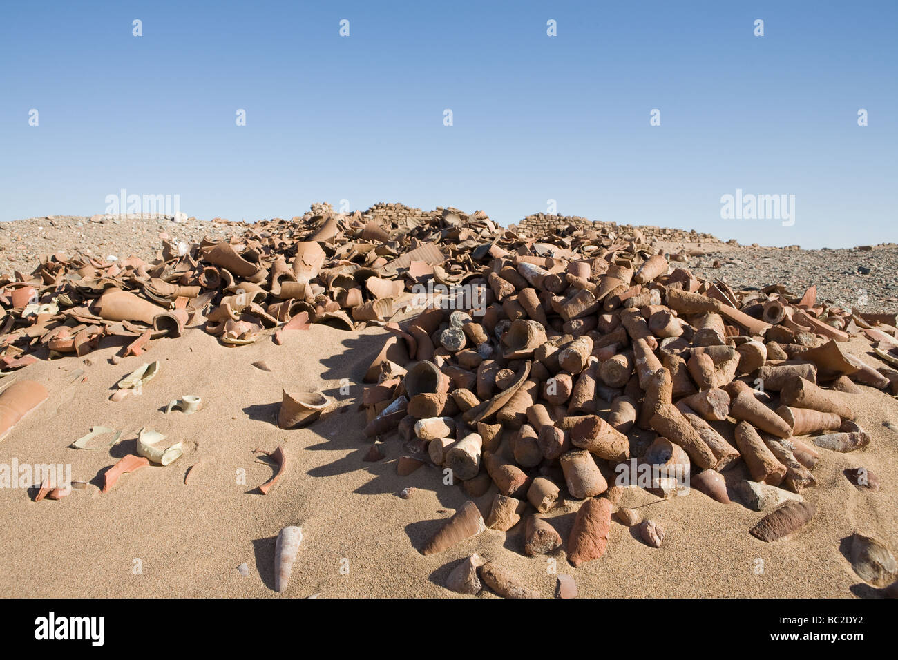 Piles of ancient pottery shards on the desert floor at Daydamus Roman Fort in the Eastern Desert of Egypt , North Stock Photo