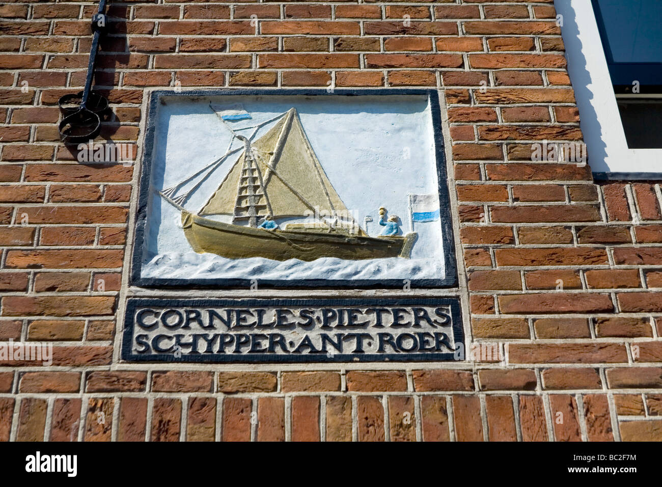 yachtsman trade signal in a wall house. Monnikendam , Netherlands, Europe - Stock Image