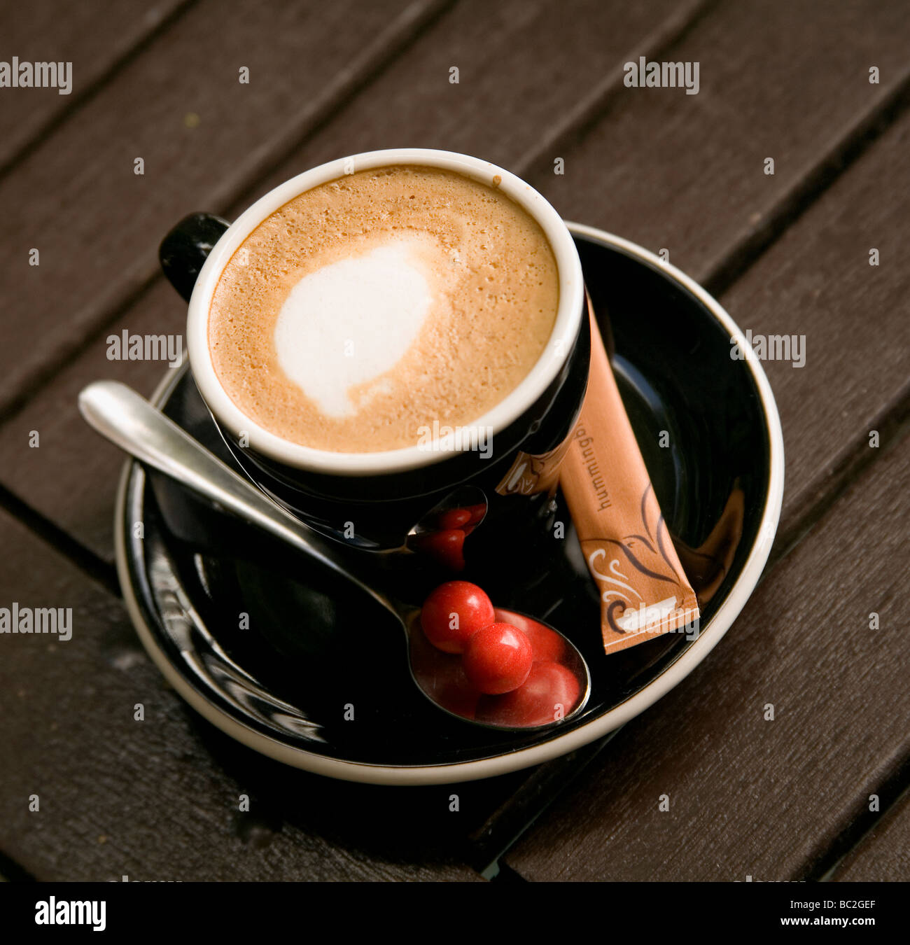 A cup of flat white coffee, a popular drink in New Zealand - Stock Image
