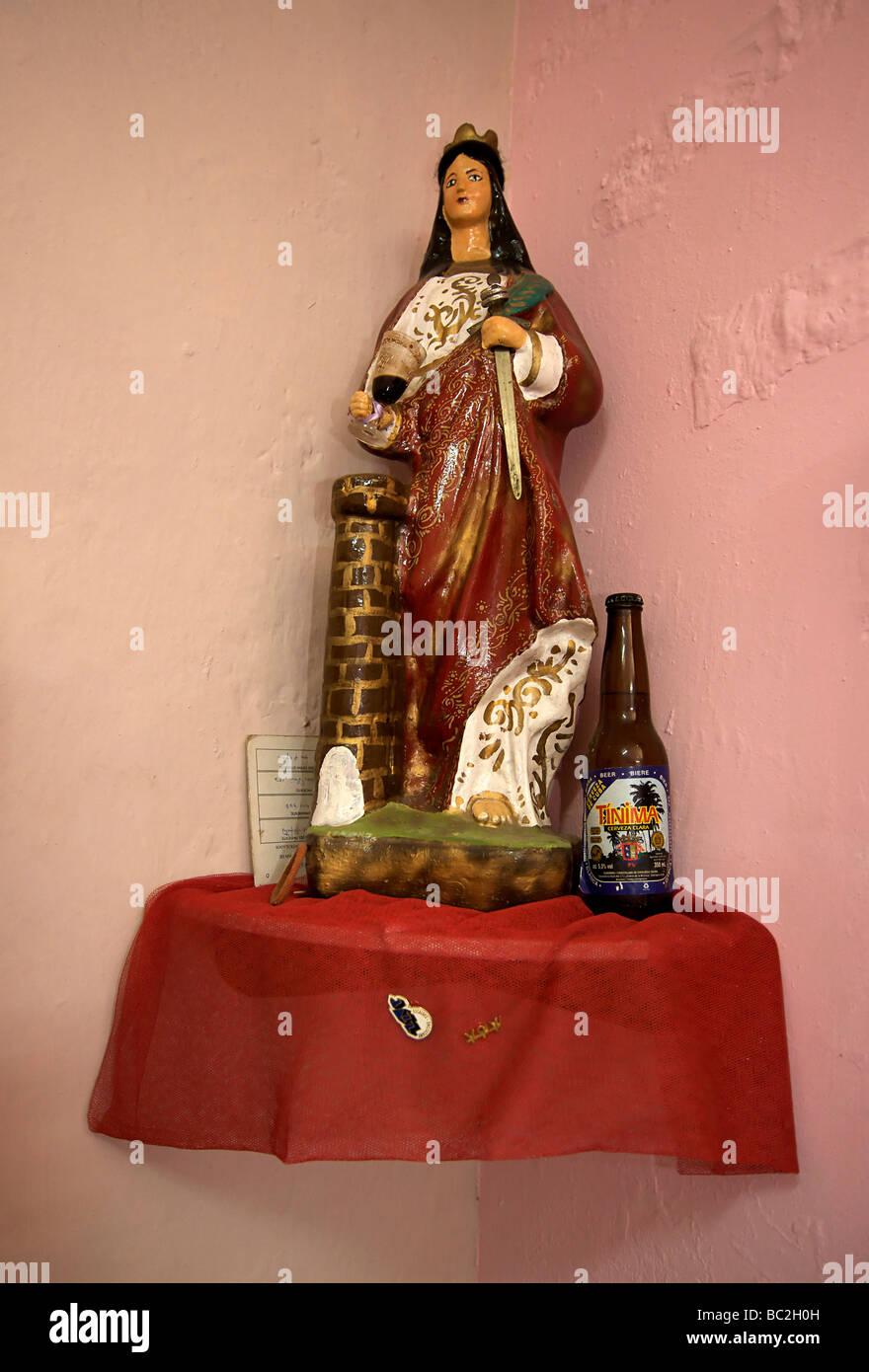 Statue of Santa Barbara, revered in the religion of Santeria. Home altar, Havana, Cuba - Stock Image