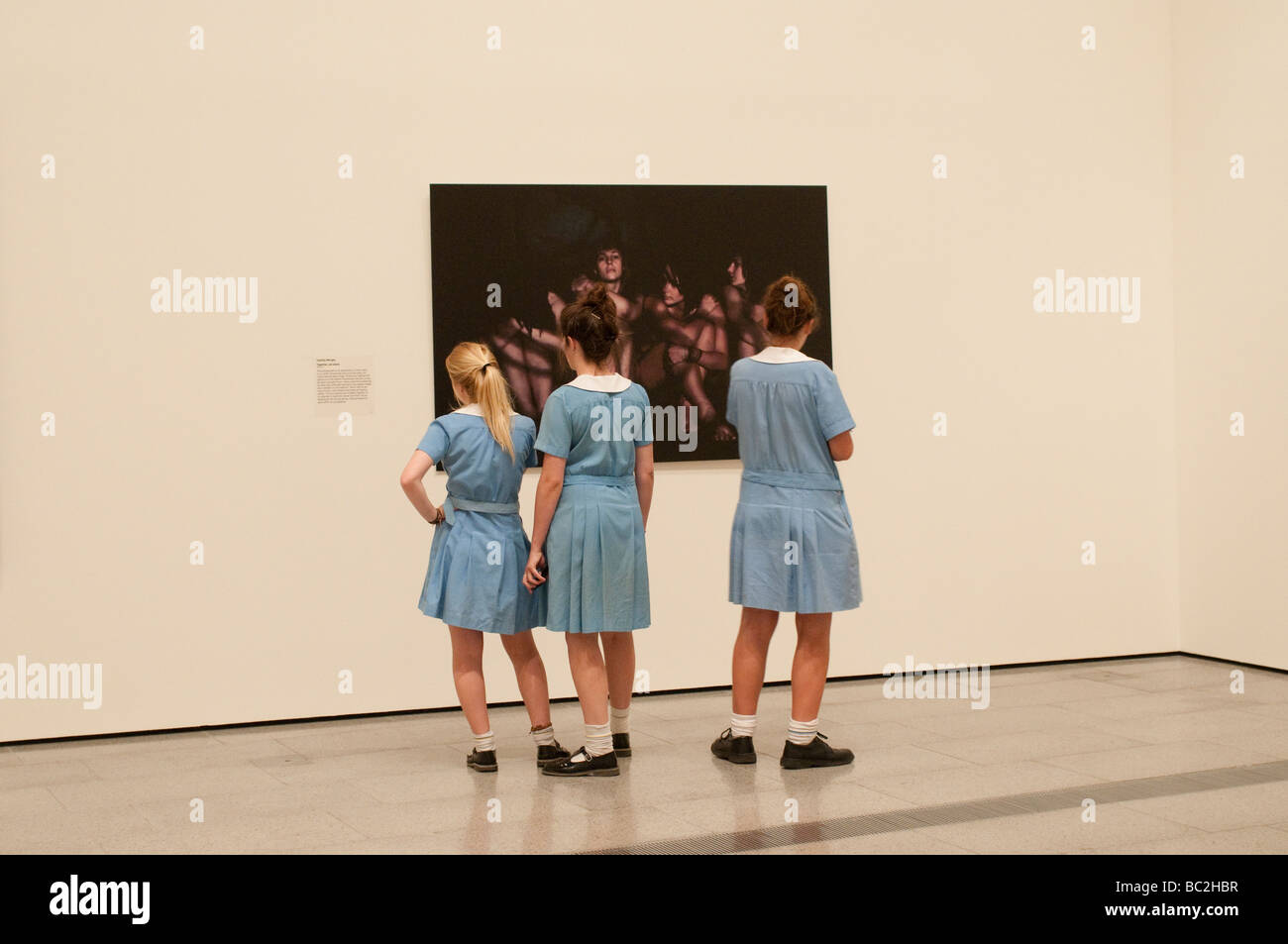 National Gallery of Victoria, Schoolgirls looking at a painting, Melbourne, Victoria, Australia - Stock Image