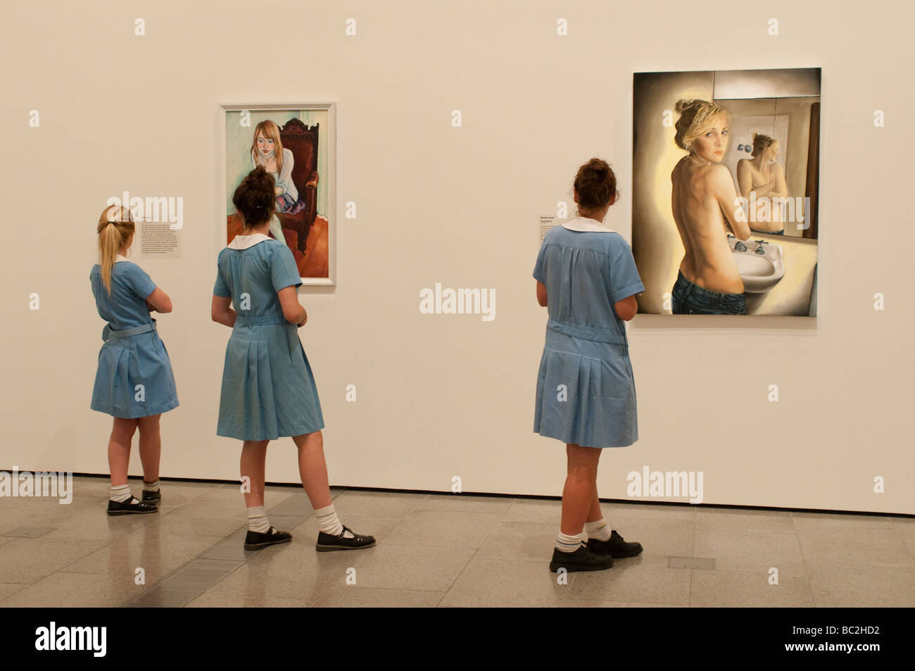 National Gallery of Victoria, Schoolgirls looking at paintings of young women, Melbourne, Victoria, Australia - Stock Image