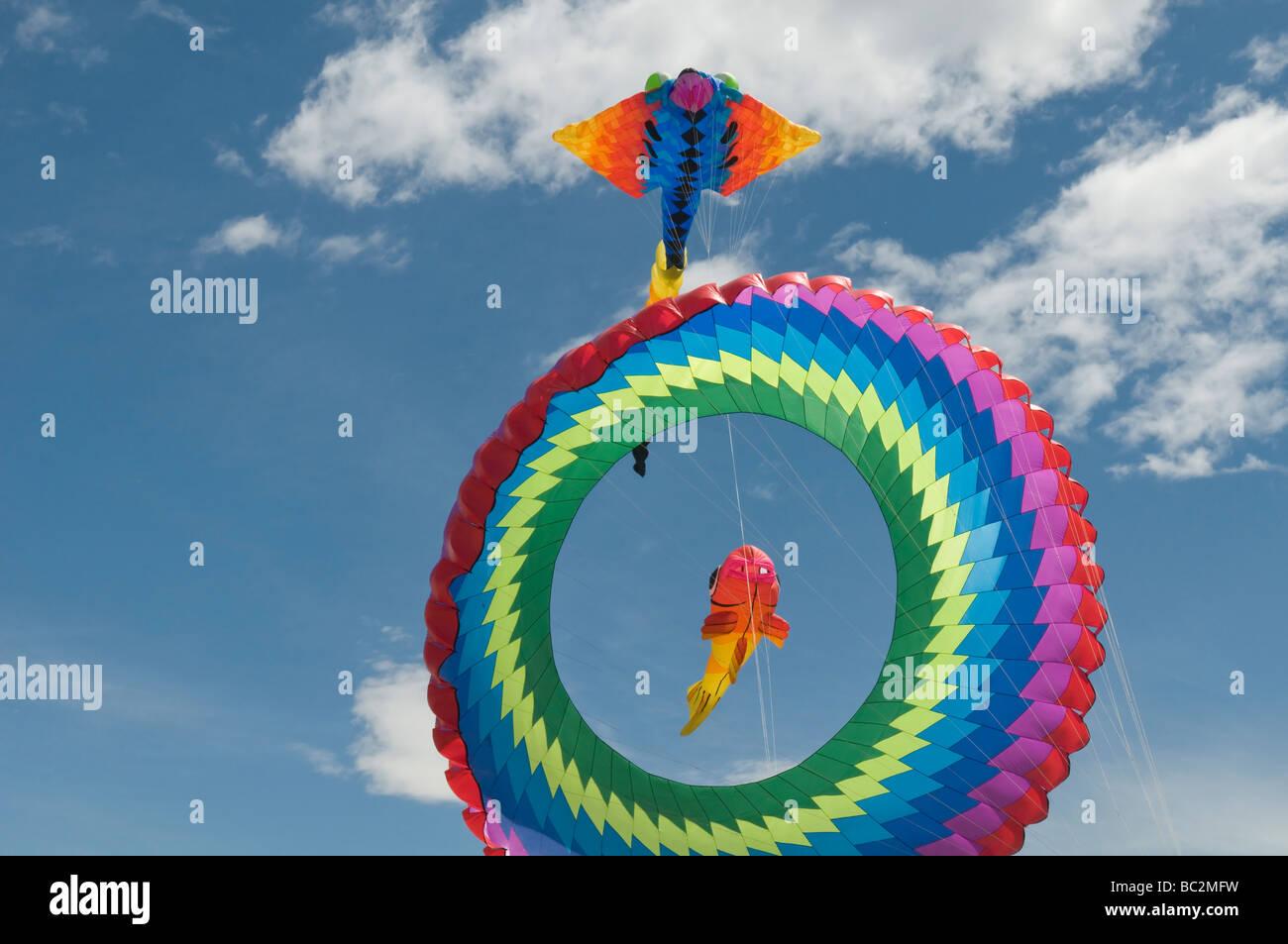 Circular Bol kite in rainbow colours - Stock Image