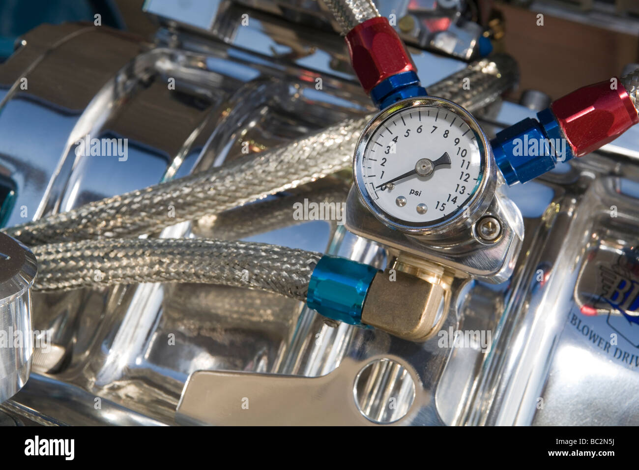 Fuel pressure gauge on heavily modified V8 show performance car engine - Stock Image