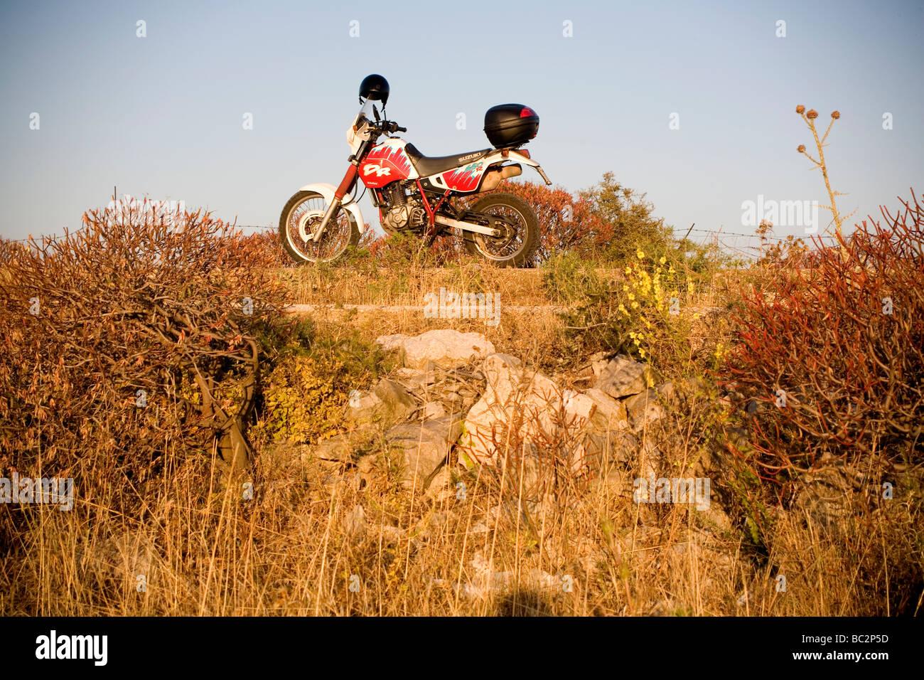 Suzuki DR 650 off road Bike in countryside - Stock Image