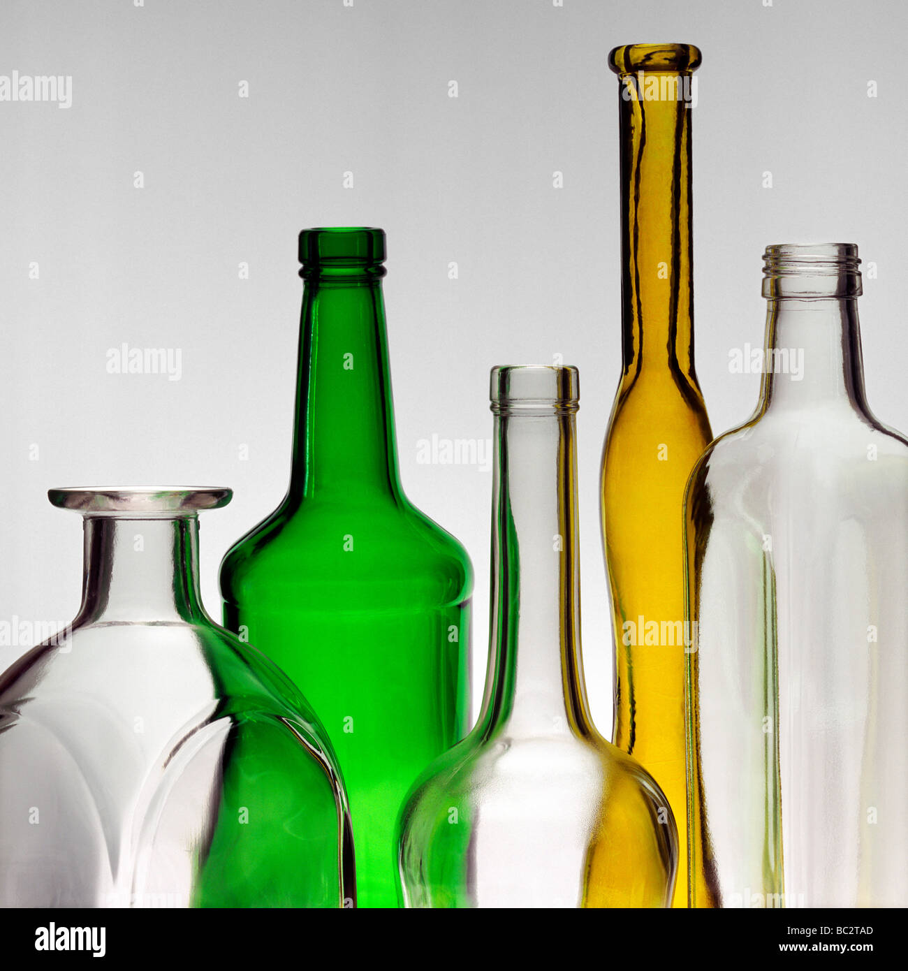 Still life of the of colored and non colored glass bottles - Stock Image