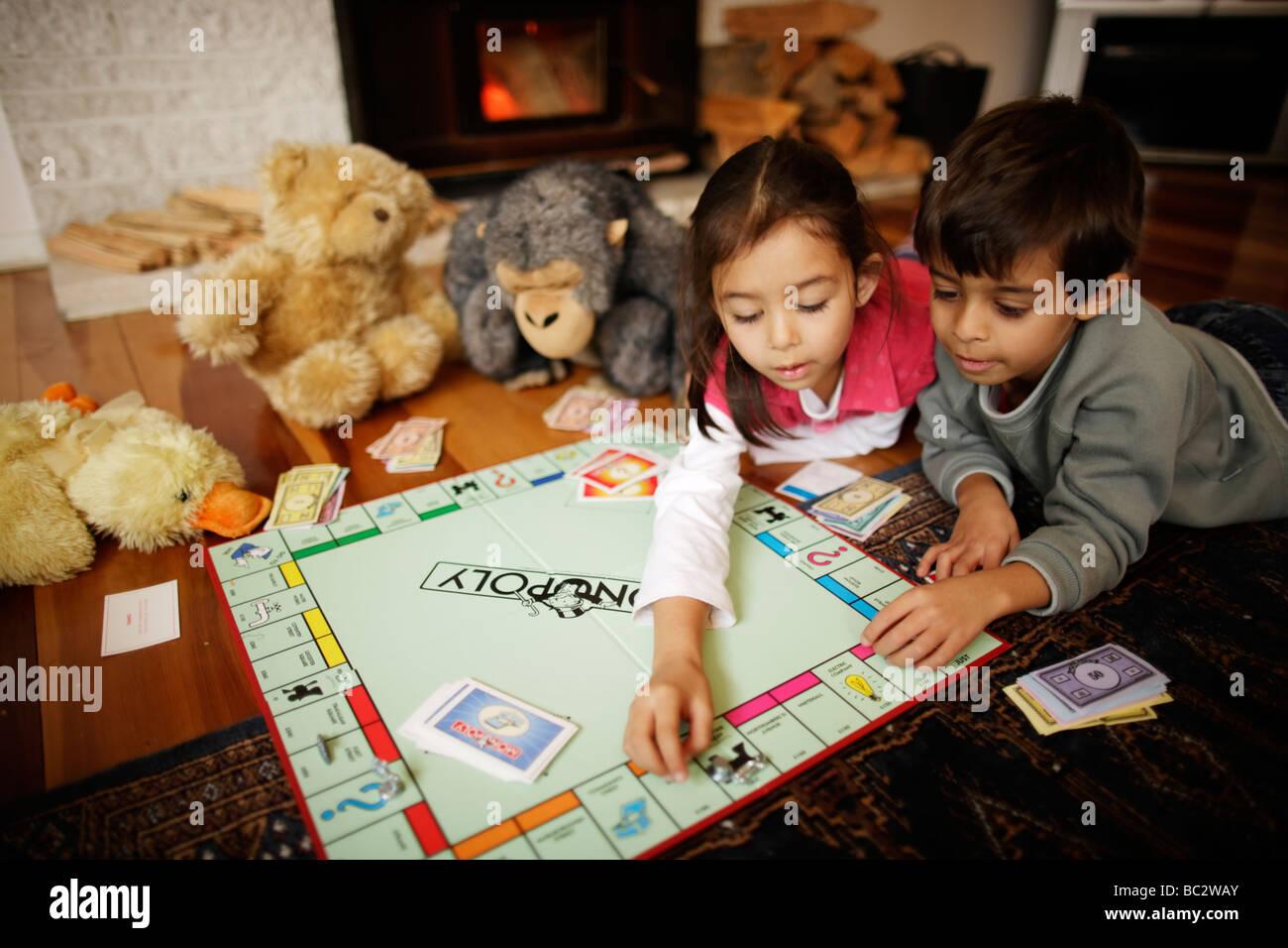 Children play Monopoly - Stock Image