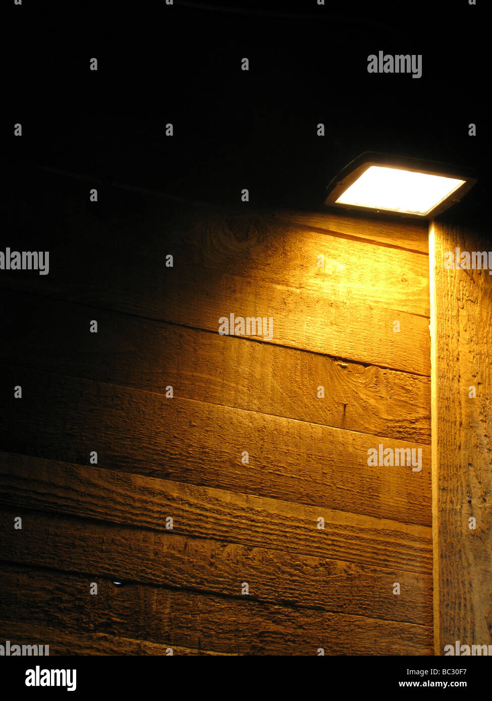 one bright spot light and high wooden wall at night & one bright spot light and high wooden wall at night Stock Photo ...