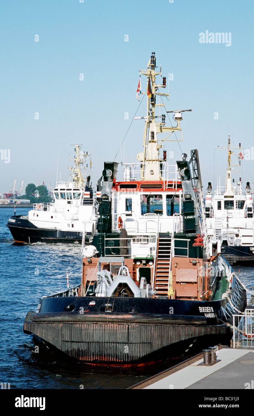 June 23, 2009 - Tugboats at Landungsbrücken in the German port of Hamburg. - Stock Image
