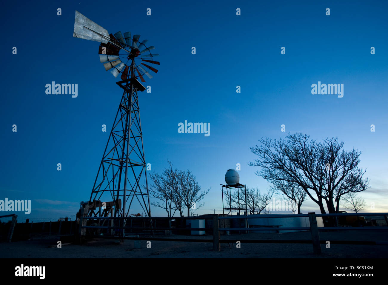 A windmill pumps water to livestock on a Mexican ranch in Chihuahua. - Stock Image