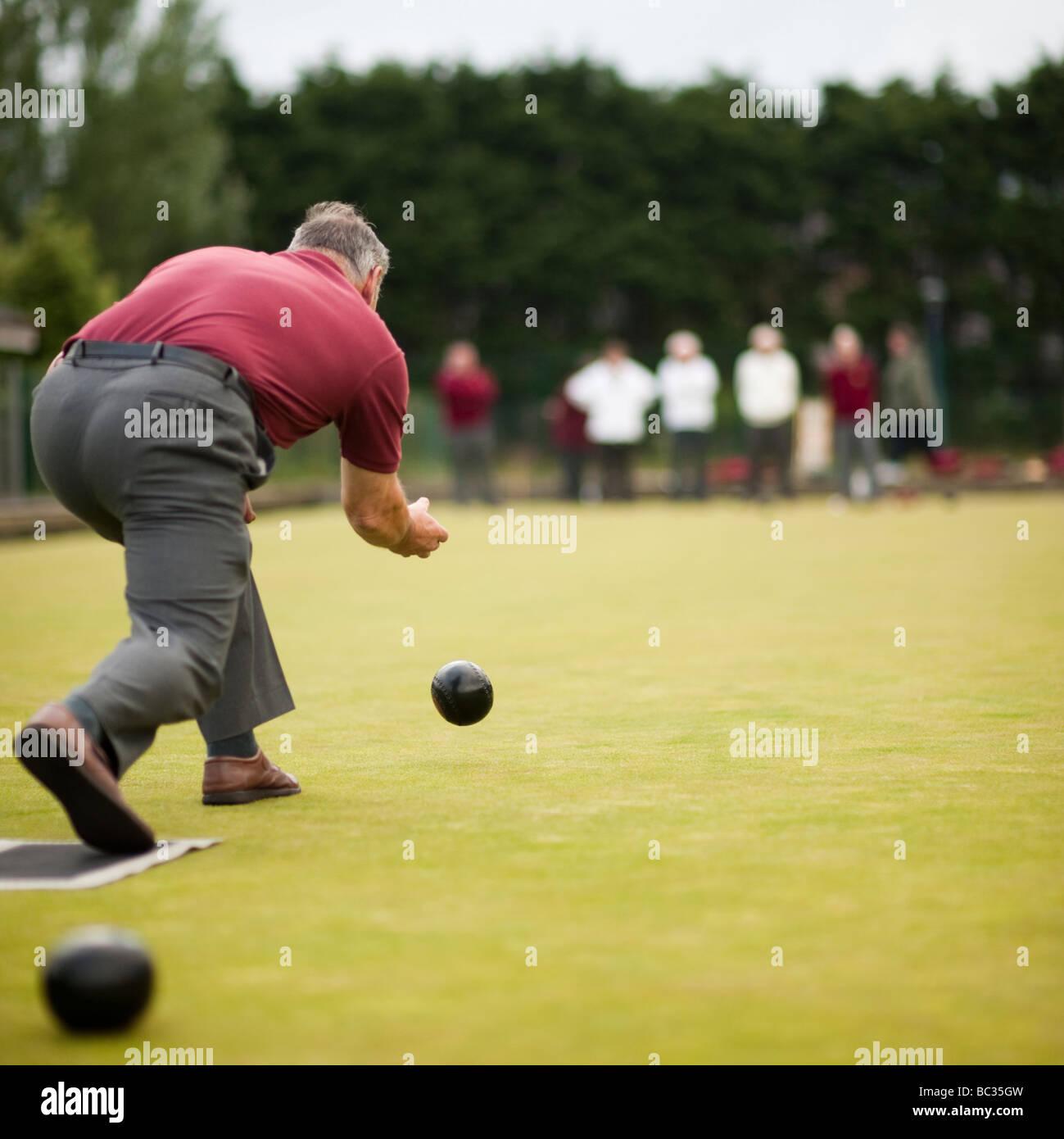 A man playing lawn green bowls  UK - Stock Image