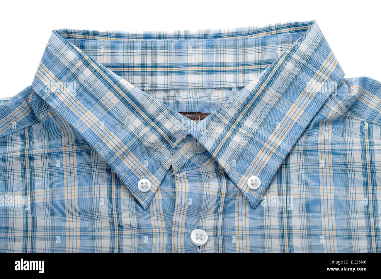 Mans buttoned down collar on a blue checked shirt - Stock Image