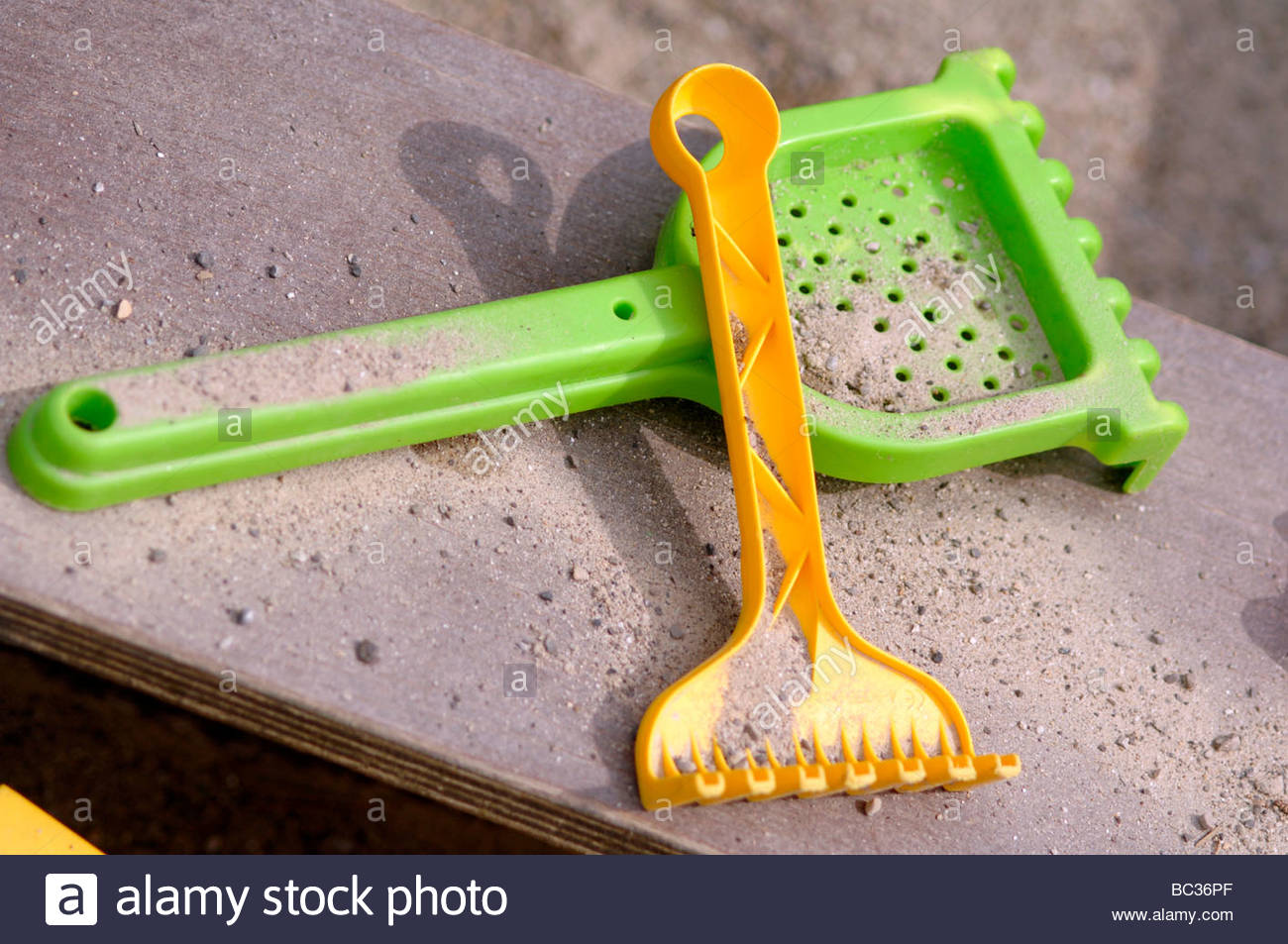 Sandbox with playthings - Stock Image