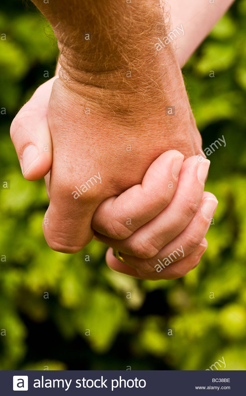 Man and woman Holding hands - Stock Image