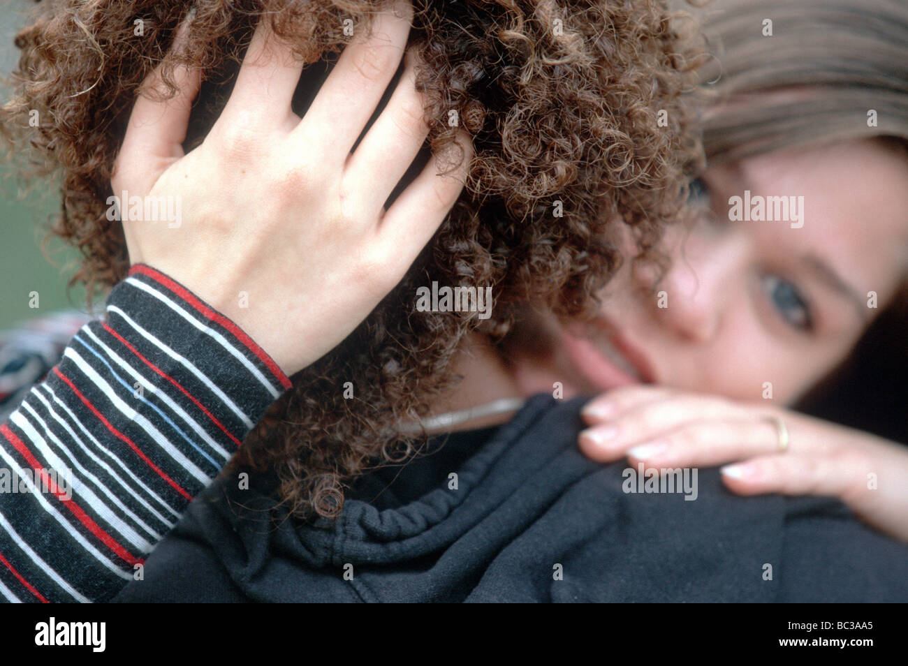 Desperate young woman in love with immigrant, close up  SerieCVS117005 - Stock Image
