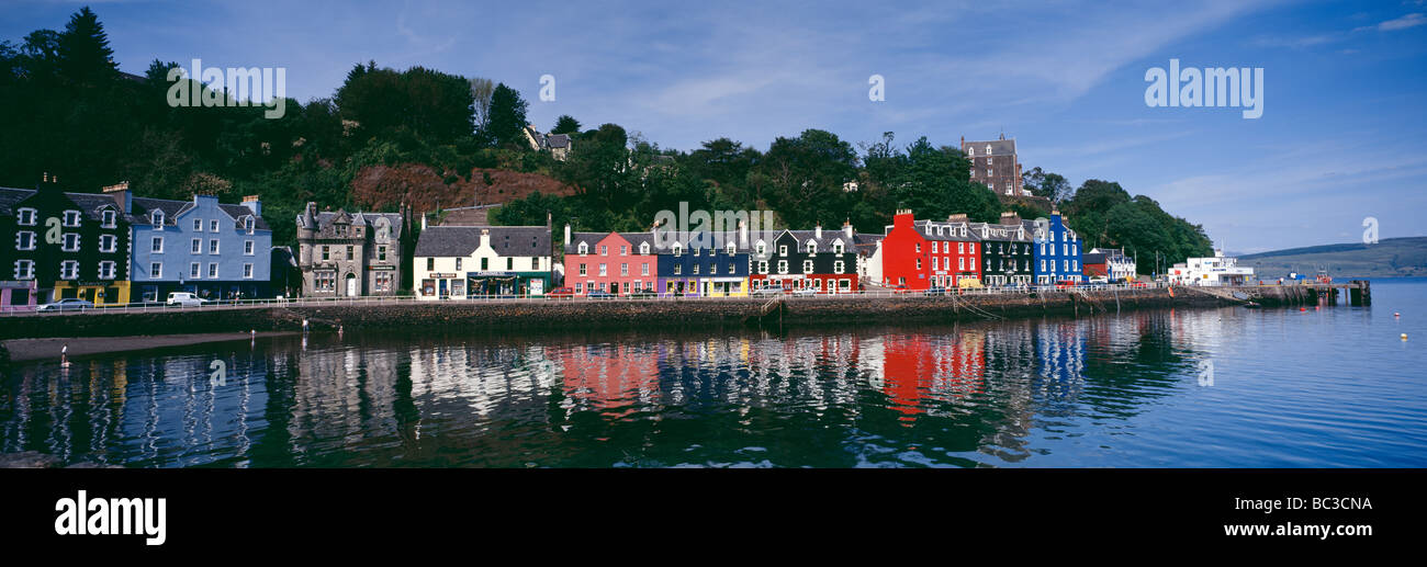 Panorama with reflections of Tobermory Bay, Isle of Mull, Inner Hebrides, Scotland. - Stock Image