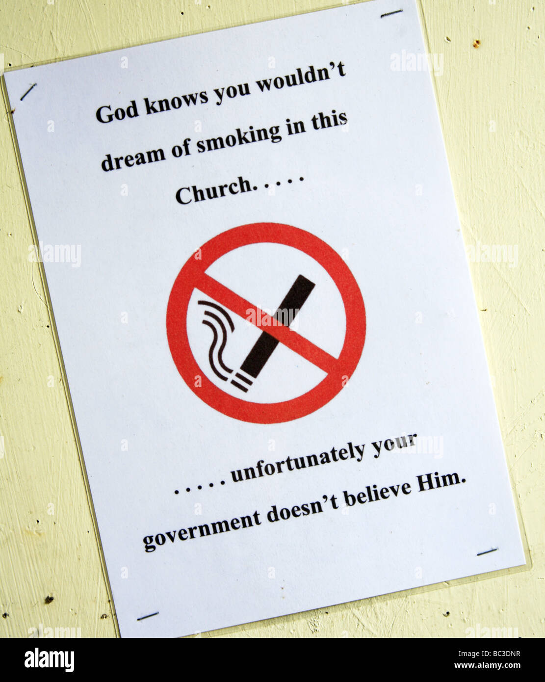 Amusing No Smoking Sign in the Entrance to a Church - Stock Image