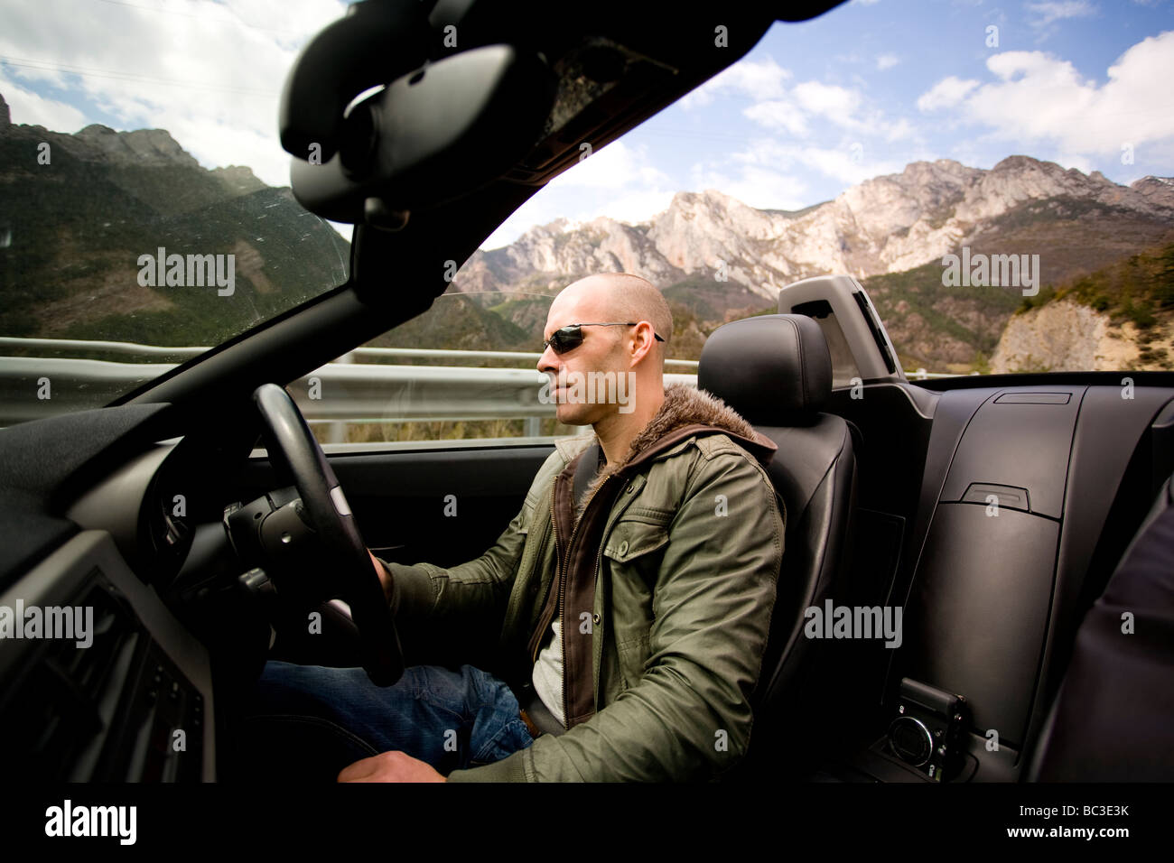 Driving through the Pyrenees and Andorra in an open top sports car. - Stock Image