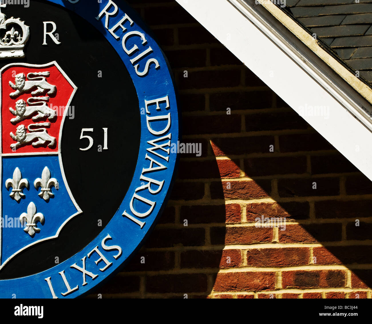 A section of the crest of King Edward VI Grammar School in Chelmsford. - Stock Image