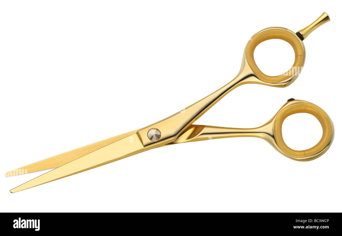 A pair of golden scissors. - Stock Image