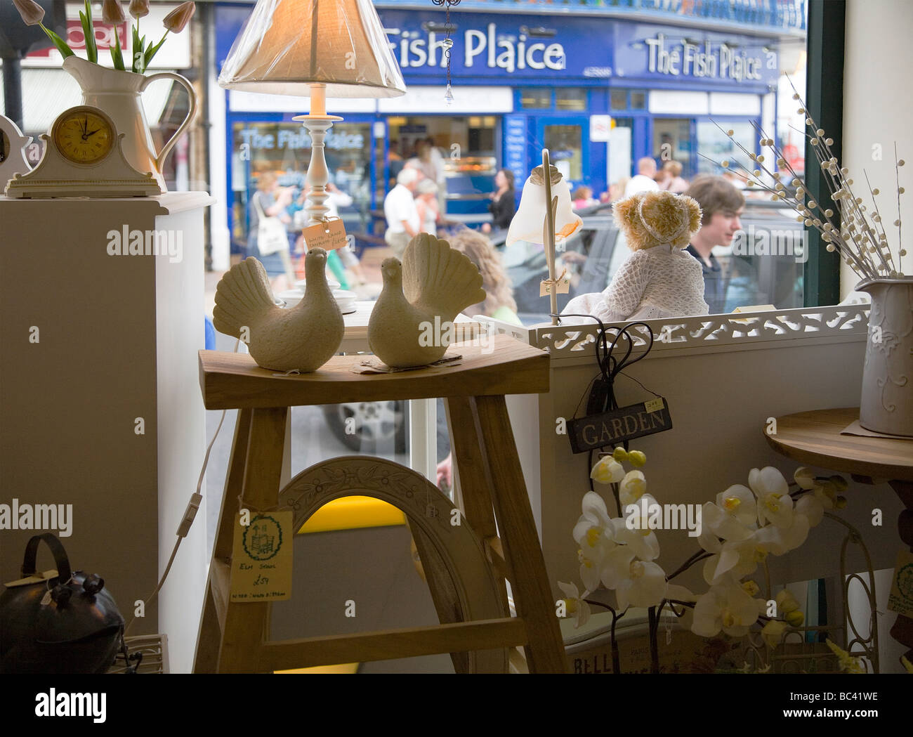 Interior of arts and crafts shop in the seaside town of Swanage, Dorset. UK. View of The Fish Plaice restaurant - Stock Image