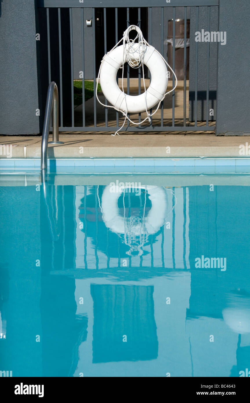 Reflection of life saver in pool. - Stock Image